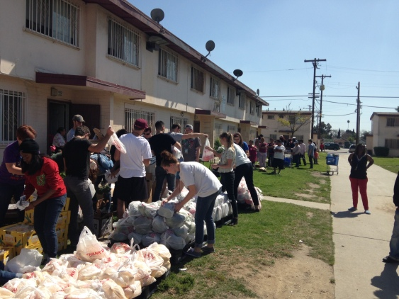Passing out food in Compton