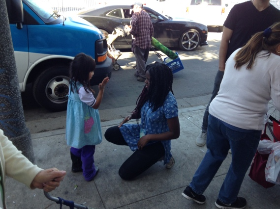 Ife, playing with a girl at LA food truck