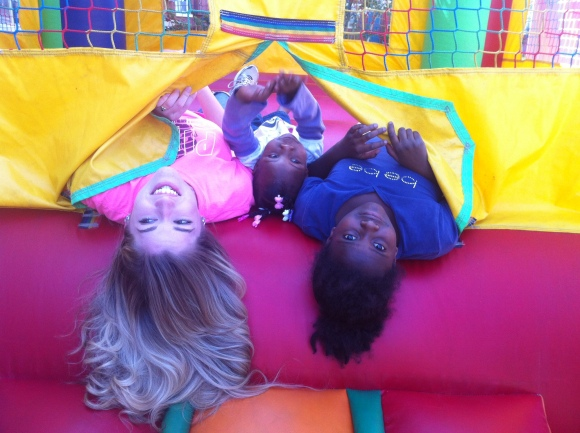 Hannah and the kids on the bouncy house