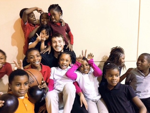 Cole at the Dream Center, playing with the kids, Copyright 2014, used with permission by Cole Yarbrough